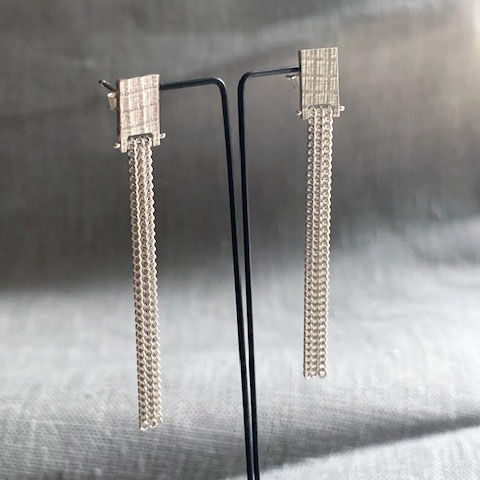 WOVEN chain fringe studs