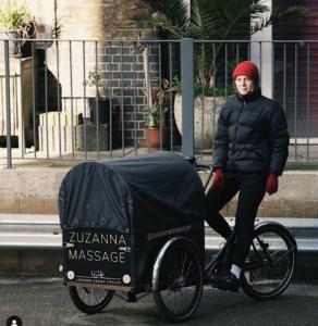 Massage therapist on cargo bike