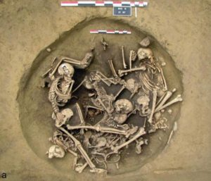 A photo and a drawing of the skeletons in a layer above the layer that contained the amputated human arms