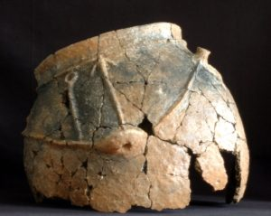 A decorated storage vessel. It is hard work for archaeologists to piece together the scattered shards.