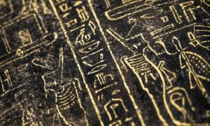 Hieroglyphs carved on a black wooden sarcophagus inlaid with gilded sheets, dating back to between the seventh and fourth centuries BC.