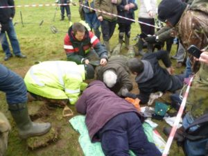 Members of the Weekend Wanderers Detecting Club work to uncover an inredible hoard of silver Anglo Saxon coins worth more than £1 million
