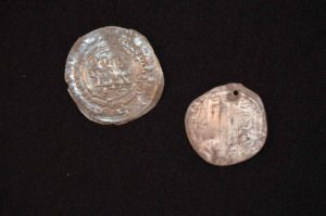 These silver coins were found in the grave of a Viking woman buried outside the tomb at the Haarup archaeological site.