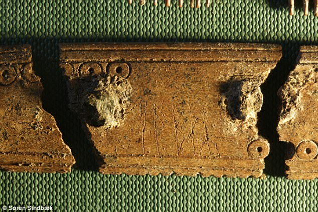 A magnified view of the runes etched on one part of the comb. Both sides contain the word 'comb.' On one side it is the verb (to comb) and the other the subject, comb. It was possibly inscribed by two different people