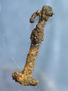 AN AMULET OF THOR'S HAMMER FOUND AT THE SITE. PHOTOGRAPH COURTESY ANDRES S. DOBAT, AARHUS UNIVERSITET