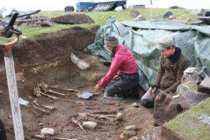 Archaeologists dig up skeletons of Norse settlers in 2010 at the Norse farm Ø64, Igaliku Fjord, Østerbygden, Greenland.