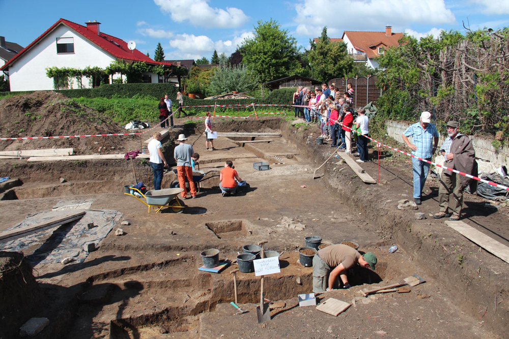 The public watches as students dig for artifacts within the remains of a 1,900-year-old Roman fort that once quartered 500 troops in what is today Gernsheim in Germany.