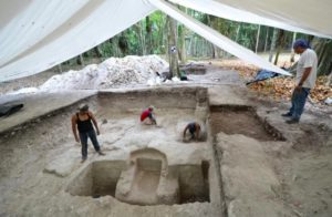 Archaeologists covered the site with a tent to protect it.