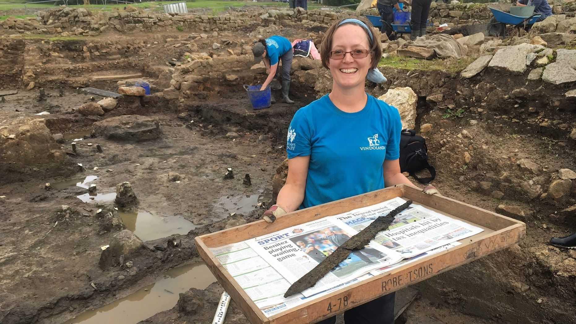 Volunteer Sarah Baker who discovered the second sword at Vindolanda (The Vindolanda Trust).