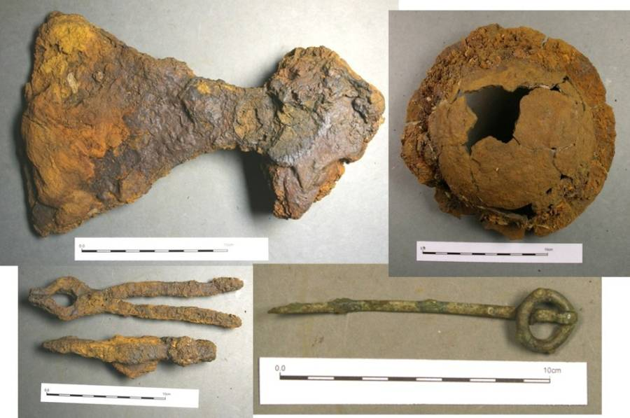 Clockwise from the top left: broad-bladed axe, shield boss, ringed pin, and hammer and tongs.