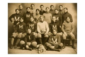 "A team portrait of the ""M"" football team, c1904. In the 1904 season alone, there were 18 football deaths and 159 serious injuries."