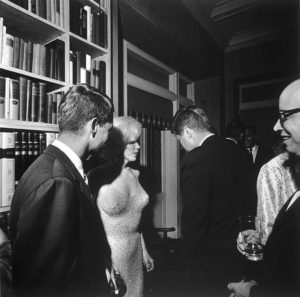Marilyn Monroe with John F. Kennedy (right) and Robert Kennedy during the iconic celebration for the president at which she sang to him. 1962.