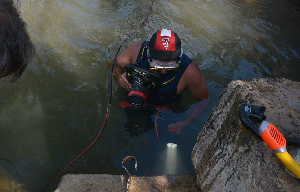 Archaeologist Kalin Chakarov is seen here during the exploration of the Ancient Roman water catchment reservoir which collected water from the karst springs inside the Musina Cave.
