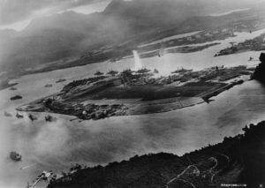 Photograph taken from a Japanese plane during the torpedo attack on ships moored on both sides of Ford Island shortly after the beginning of the Pearl Harbor attack.
