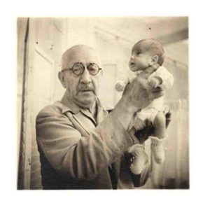 Martin Couney in 1941, holding a baby who was born weighing one pound, ten ounces. Today that baby, Beth Allen, is alive and well.