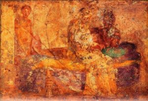 Fresco of couple in bed.