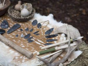 Cut and thrust: Stone Age tools and flint blades arranged on an animal pelt