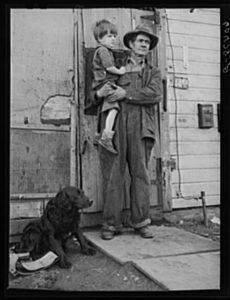 Residents of river bottom's shacktown.