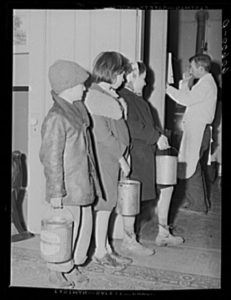 Children are waiting in a line for soup given out each night by the city mission, a community chest- financed organization.