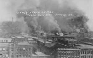 Little Africa on Fire. Tulsa Race Riot, June 1, 1921 Apparently taken from the roof of the Hotel Tulsa on 3rd St. between Boston Ave. and Cincinnati Ave. The first row of buildings is along 2nd St. The smoke cloud on the left (Cincinnati Ave. and the Frisco Tracks) is identified in the Tulsa Tribune version of this photo as being where the fire started.