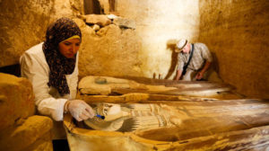 Archaeologists work on an ancient Egyptian limestone tomb of two priests from the Fifth Dynasty discovered recently near the Pyramids of Giza.
