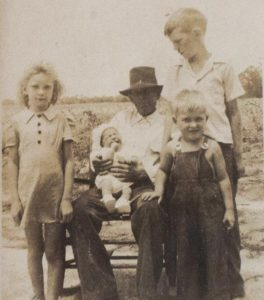 Murder victim Mary Emma Thames, left, is seen with her family in a photograph taken around 1943. Someone killed Mary Emma and her friend Betty June Binnicker in 1944.