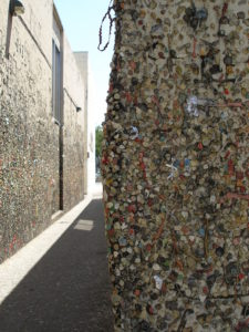 Thousands of pieces of gum are attached to the walls.