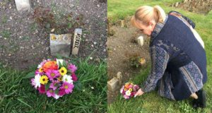 """Jo Vigor-Mungovin lays flowers on an unmarked grave suspected to belong to Joseph Merrick, also known as """"The Elephant Man."""""""
