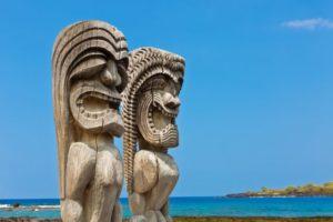 "Pu'uhonua o Honaunau National Historical Park on the Big Island of Hawaii. The ""Ki'i"", wooden images of the gods, stand on the shore of the historic park as guardians of the inhabitants of the historic village."