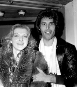 Singer Freddie Mercury of Queen photographed in September 1977 with his girlfriend Mary Austin.