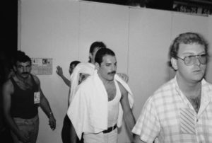 Freddie Mercury backstage at the Live Aid concert at Wembley, July 13, 1985. On the left is his boyfriend Jim Hutton.