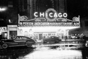 People arriving at the Chicago Theatre for show starring, in person, Jack Carson, Marion Hutton, and Robert Alda, 1949. Image from Look photographic assignment 'Chicago City of Contrasts' by S. Kubrick.
