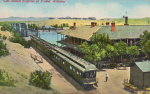"Early 20th-century postcard of the ""Sunset Express"" train passing through Yuma, Arizona."