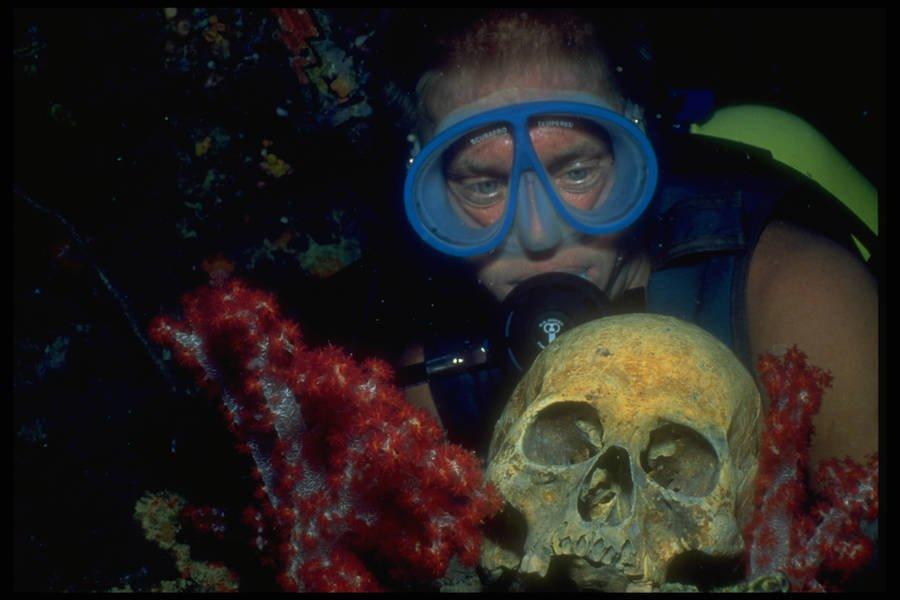 A scuba diver finds a human skull in Truk Lagoon.
