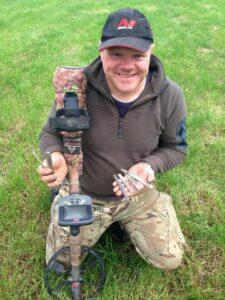 Derek McLennan, 47, holding ingots from the hoard of Viking treasure