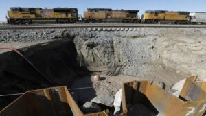 Union Pacific Railroad has already had to move its freight trains to an alternate temporary track because the mud pot has moved so close to the railroad line
