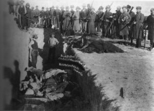Burial of the dead after the massacre at Wounded Knee, 1891.