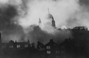 St Paul's Cathedral, rising above the bombed London skyline, is shrouded in smoke during the Blitz.