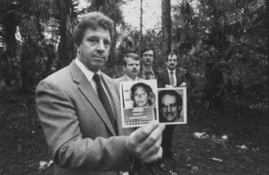 Investigators Richard Vogel, Bob Kelley, Larry Horzepa, and Jake Erhart hold mug shots of Wuormos and her first victim, Richard Mallory.
