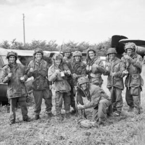 Members of 12th Parachute Battalion, 5th Parachute Brigade, 6th Airborne Division, enjoy a cup of tea after fighting their way back to their own lines near Ranville after three days behind enemy lines, June 10, 1944