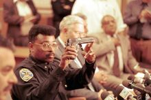 SFPD Commander Richard Holder holds the gun that Ferri used to kill himself