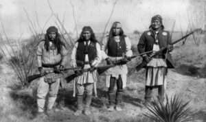 Apache warrior Geronimo (right) and his warriors from left to right: Yanozha (Geronimos´s brother-in-law), Chappo (Geronimo´s son of 2nd wife) and Fun (Yanozha´s half brother) in 1886