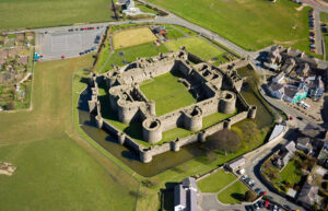 Beaumaris Castle, on the island of Anglesey at the north-west of Wales, was built in 1295. Notice the space between the smaller exterior wall and the major fortification.