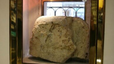 London Stone is an historic artifact now housed behind an iron grill in Cannon Street