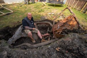 Man Finds Classic 1950s Car Buried in his Backyard While Gardening