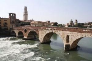 The Ponte Pietra:Roman arch bridge crossing the Adige River in Verona, Italy.