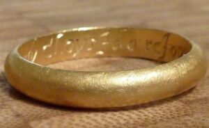 The inscription reads: 'In thee my choys I do rejoys', which is a typical message found in gold posy rings