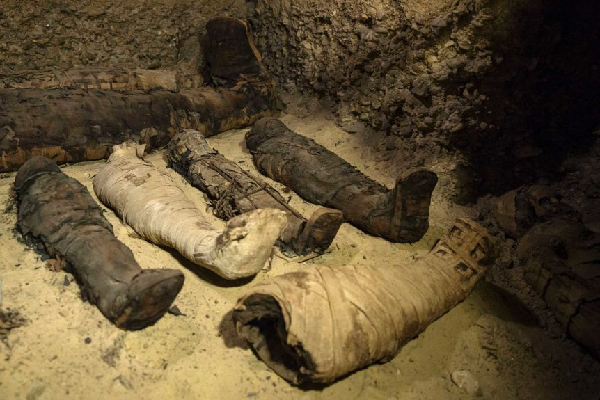 Egyptian archaeologists discover 50 mummies at ancient burial site