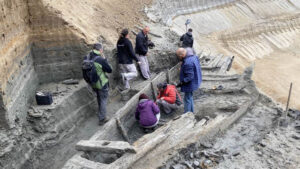 Archaeologists look at the front section of a wooden Roman ship dated to the 3rd century AD, at the ancient city of Viminacium, Serbia