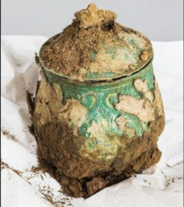 One of the rarest objects in the hoard was this finely wrought Carolingian vessel.  Still encrusted with pieces of textile,  the vessel was jam-packed with brooches and other medieval treasures.